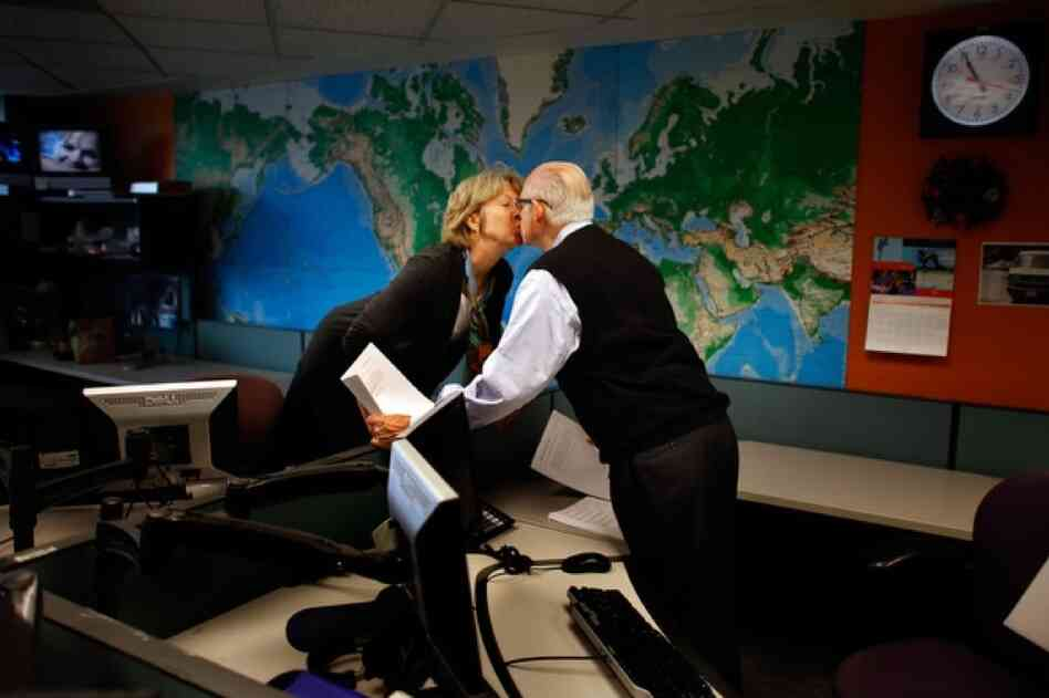 Fellow newscaster Jean Cochran gives Kasell a kiss at 10:55 a.m., moments before he delivered his final