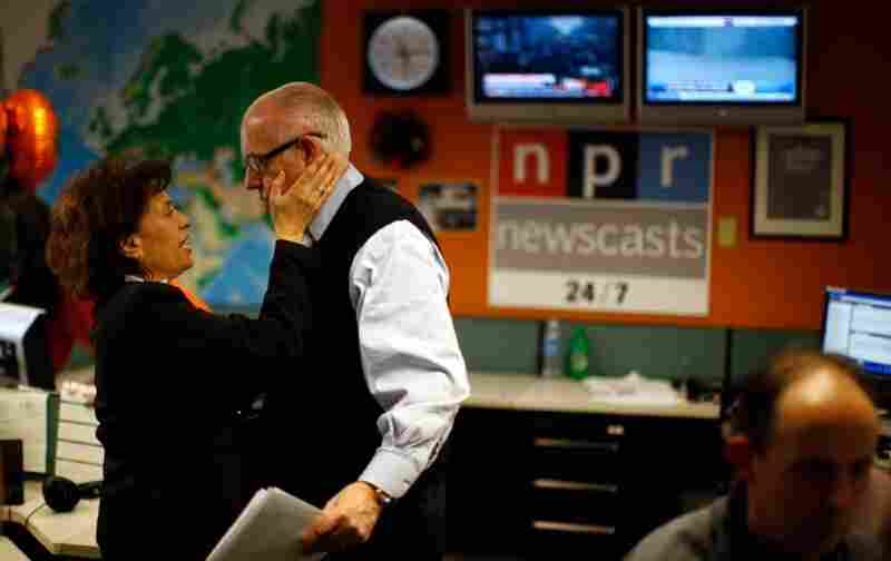 Newscaster Barbara Klein congratulates Kasell after his final news update.
