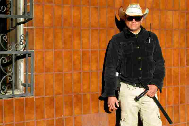 A security guard posted outside the Piscis Restaurant in downtown Juarez. The simple seafood restaurant was robbed at gunpoint in September.