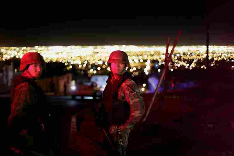 Soldiers patrol on the outskirts of Ciudad Juarez. The city sits just across the Rio Grande from El Paso, one of the safest cities in America.