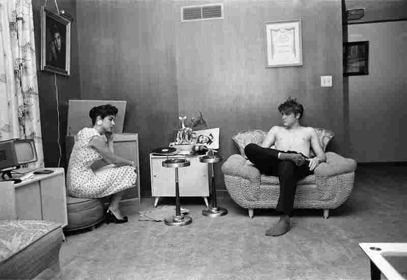 Elvis and Barbara Hearn. After having taken a shower, Elvis has his high school sweetheart, Barbara Hearn, listen on the phonograph to the acetate disc with cuts of his songs from the New York recording session. 1034 Audubon Drive, Memphis, Tenn., July 4, 1956