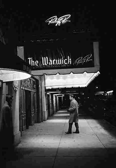 "Entering The Warwick. Between the afternoon rehearsal and the evening performance of ""Stage Show,"" hosted by Tommy and Jimmy Dorsey, Elvis returns to his hotel to rest. New York City, March 17, 1956"