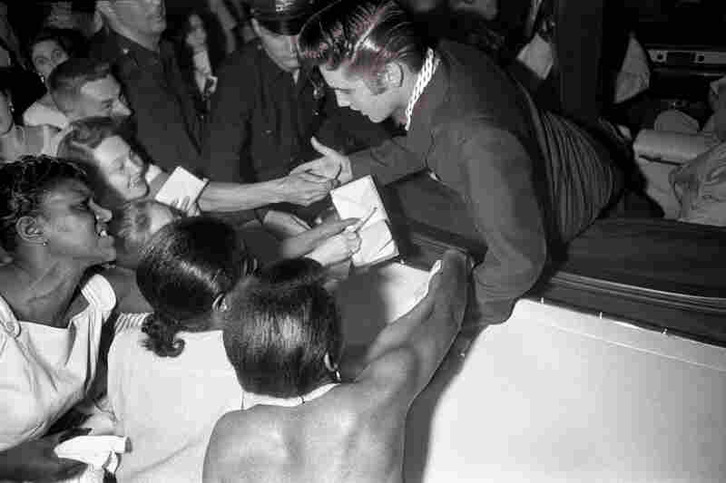 Four Desperate Fans. As Elvis left the Hudson Theater, his fans reached out for an autograph and to touch their idol. NBC Television, Hudson Theater, New York City, July 1, 1956