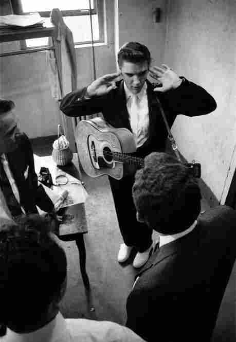 The Noisy Green Room. Elvis tries to concentrate on rehearsal ... finding it hard to do so because of the screaming of his fans outside the window. He finally went to the window and asked them to be quiet. After his request they were silent. Mosque Theater, Richmond, Va., June 30, 1956