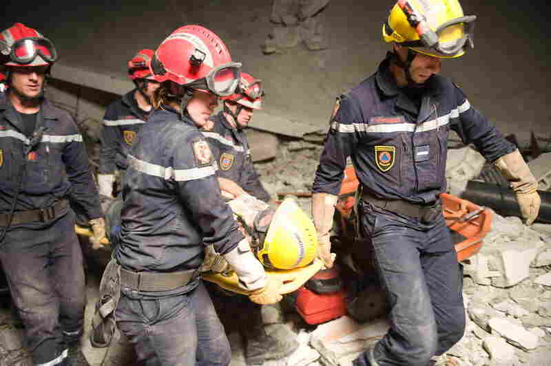 After 50 hours trapped, James Girly, 64, is rescued from the remains of the Montana Hotel by the French military.  (Nicholas Kamm/AFP/Getty Images