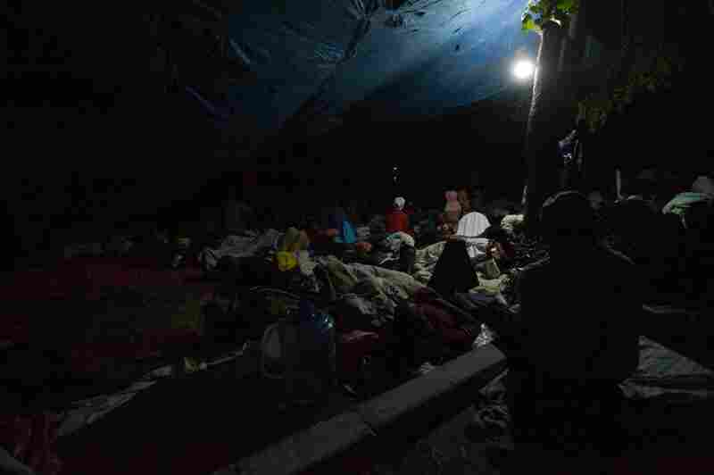 Many Haitians spent a second night on the streets. Here, people gather on a square in Port-au-Prince's Petionville district.