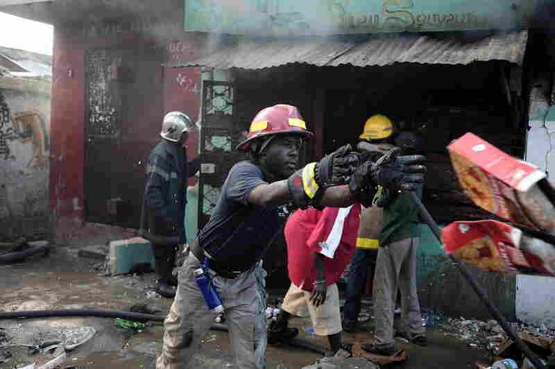 Fireman attempt to put out a blaze in Port-au-Prince Thursday.
