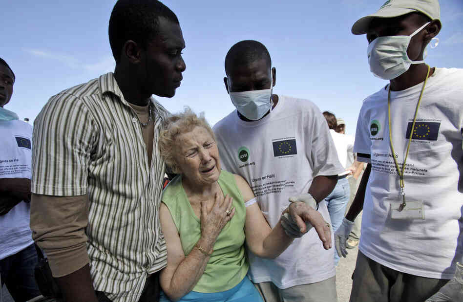 Virginia Cary, of Cleveland, Tenn. waits at the Port-au-Prince airport in hopes of a return flight to the U.S.