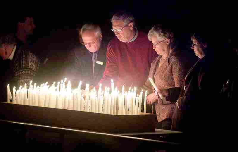 Members of the congregation of First Lutheran Church in Duluth, Minn. pray for the earthquake victims Thursday. The pastor's son is believed to have been killed in the quake.