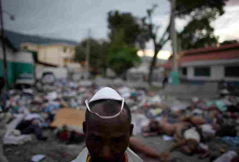 As of Thursday, as many as 50,000 people had died in the earthquake, according to an estimate from the Haitian Red Cross. A morgue worker stands amid the devastation.