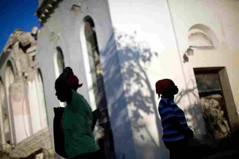 Across Port-au-Prince, people attend Sunday services in the rubble of churches.