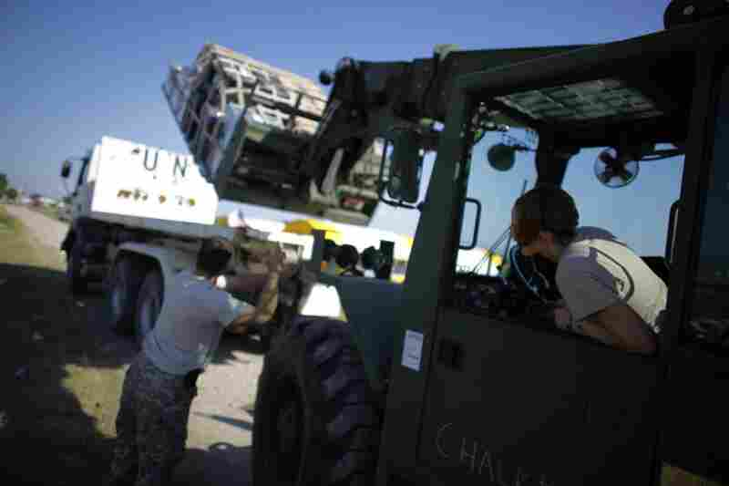 Logistics specialists load pallets for the U.S. IMSuRT (International Medical Surgical Response Team) at the airport in Port-au-Prince to send downtown to the medical clinic.