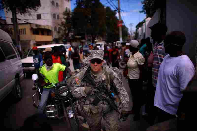Soldiers with the U.S. Army's 82nd Airborne Division walk in downtown Port-au-Prince to establish secured areas throughout the city.