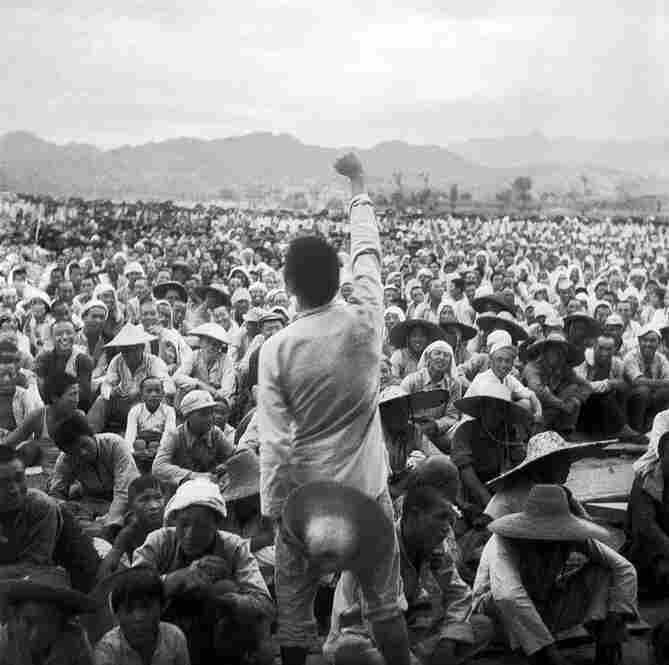 A Young Participant at an Enlistment Campaign Gathering, Fuping, Hebei Province, 1939. Sha Fei took this photograph from a position among the crowd in an enlistment campaign. It depicts a young participant as he makes a call to arms.