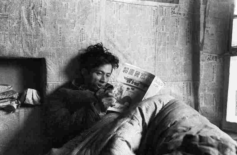 Xu Qun, Art Director of the Jin-Cha-Ji Pictorial, Reading the Pictorial's 9th and 10th Combined Issue while Recovering at the Bethune Hospital at Zhangjiakou, Hebei Province. The Jin-Cha-Ji Pictorial circulated primarily within China.
