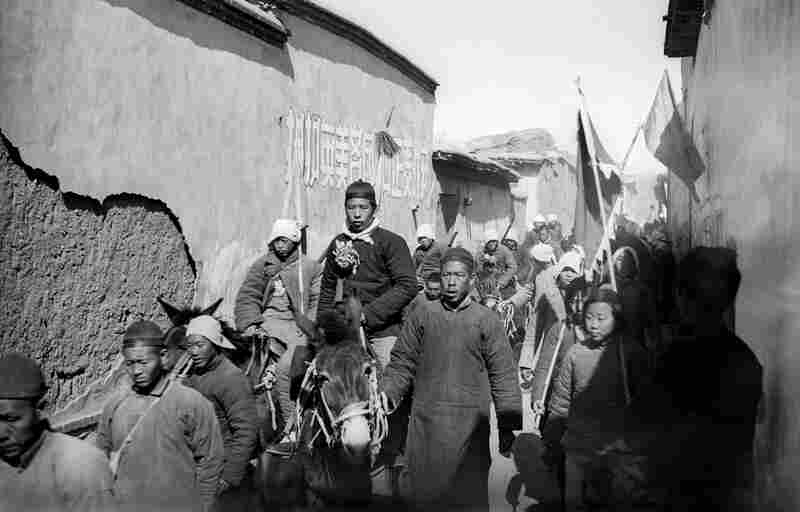 Liu Hanxing Accompanied by a Procession of Villagers as They Proceed to the Enlistment Ceremony, Pingshan, Hebei Province, 1942. Sha Fei photographed local resident Liu Hanxing as he joined a voluntary army.