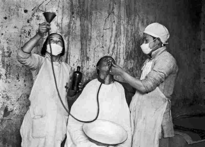 At the Ear, Nose, and Throat Department of the Bethune International Peace Hospital, Tangxian, Hebei Province, 1944. In showing Western medical treatment, Sha Fei represents the Chinese Communist Party as an agent of positive change.