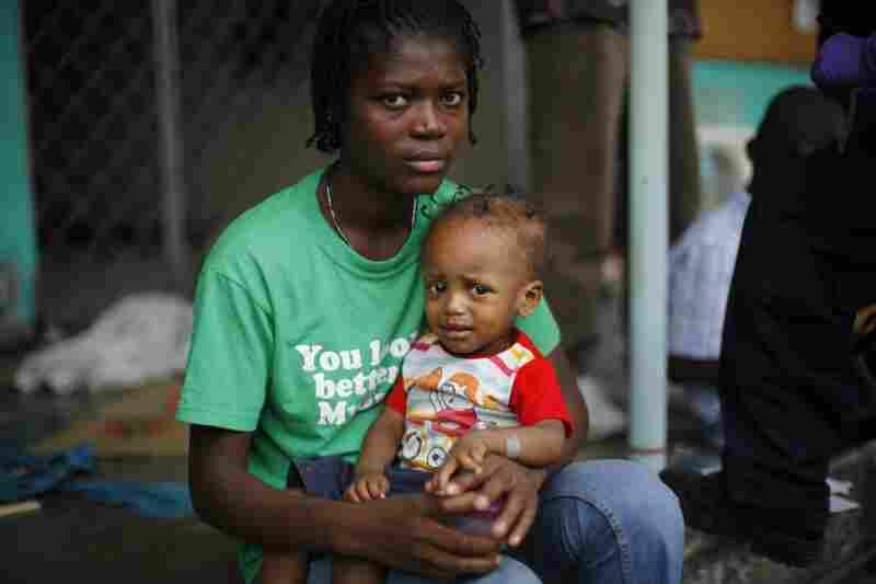 Rebecca Pierre holds sick baby Judson Abela.