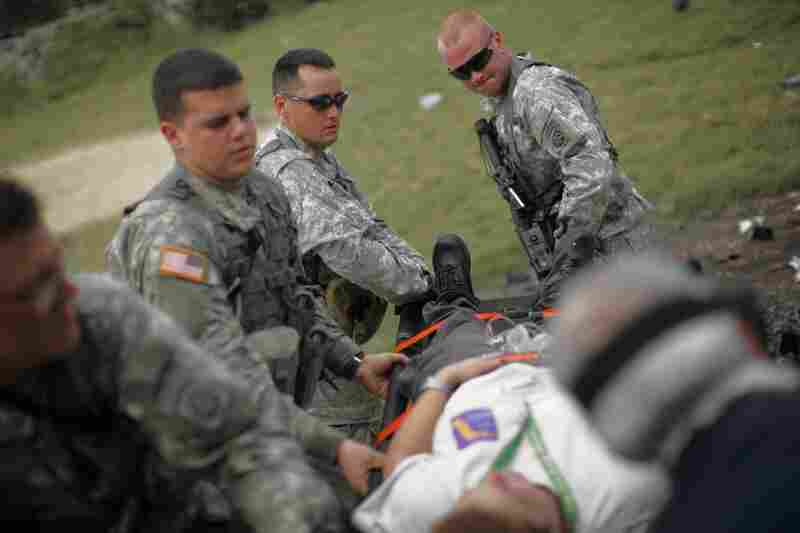 Members of the 82nd Airborne division carry nurse Yamile Fuentes to a helicopter for evacuation owing to an unspecified medical condition.