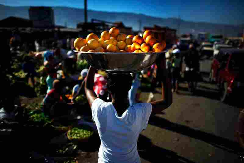 The main produce market in Port-au-Prince is open Thursday, but sellers say people aren't buying because they don't have money and the banks are closed.