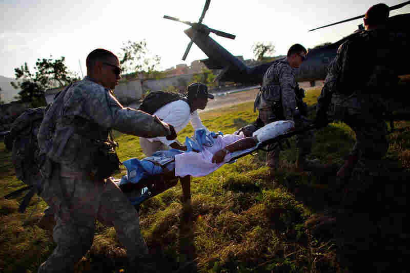 Soldiers from the 82nd Airborne load patients on a Navy helicopter in Port-au-Prince on Saturday. Some of the injured are being transported to the USNS Comfort medical treatment ship off Haiti's shore.