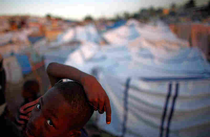A Haitian boy wanders through the camp.