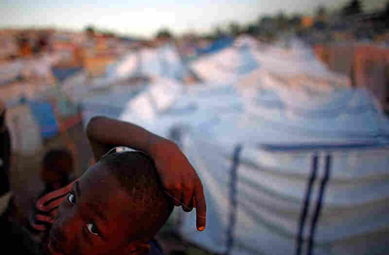 A Haitian boy wanders through the camp.