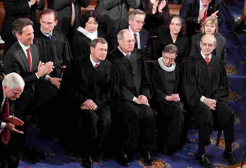 Members of the U.S. Supreme Court listen to Obama's speech.