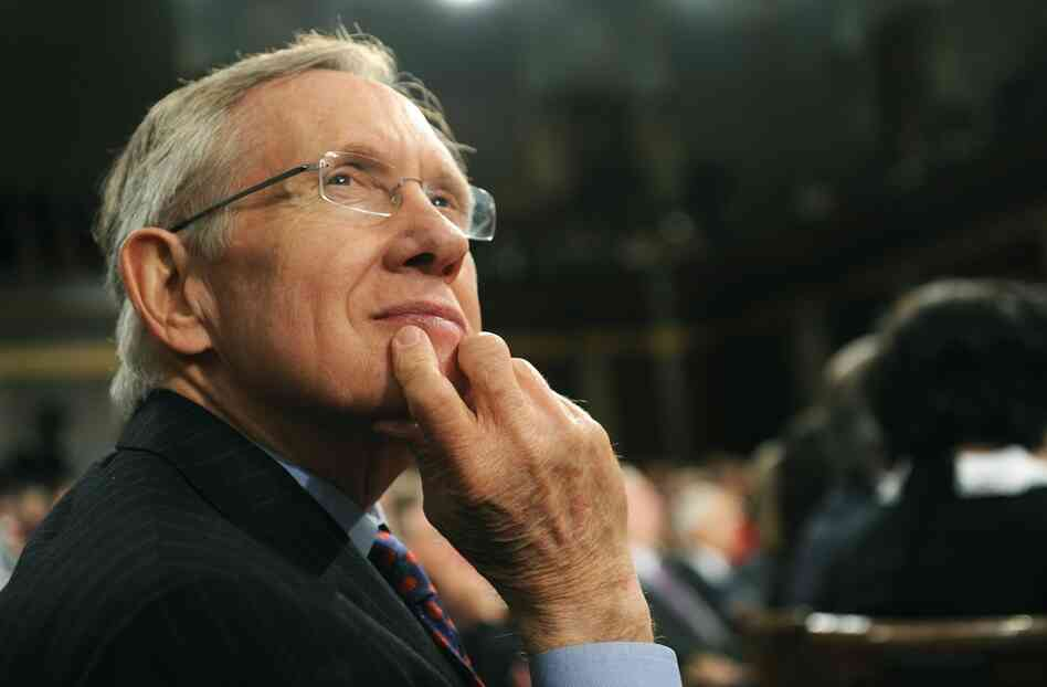 Senate Majority Leader Harry Reid listens to Obama.