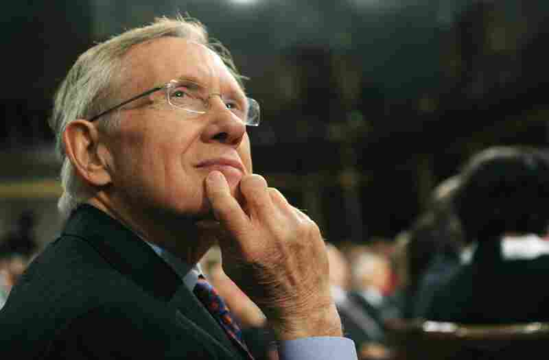 Senate Majority Leader Harry Reid listens to Obama.