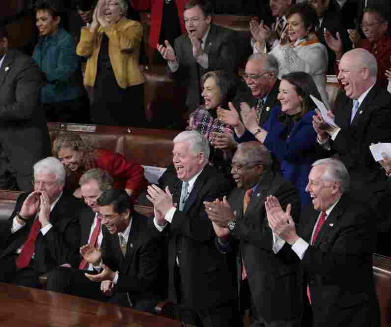 Democrats (from right) House Majority Leader Steny Hoyer of Maryland, House Majority Whip James Clyburn of South Carolina, and Connecticut Rep. John Larson applaud.