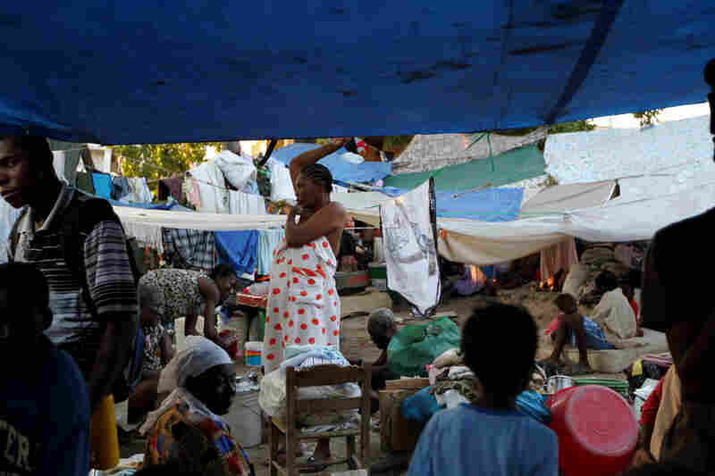 The camp is packed with several hundred men, women and children during the day. But more than 1,000 people sleep there at night. Residents say the camp has received water deliveries, but no food aid.