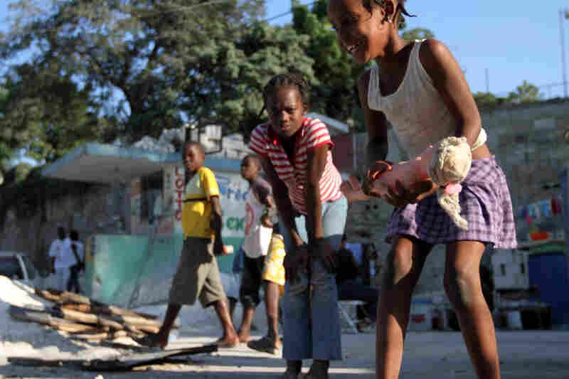 Children play amid the devastation around them.