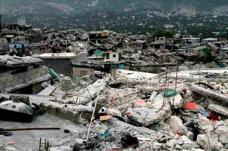 In this hilltop neighborhood, many bodies are still trapped in the debris.