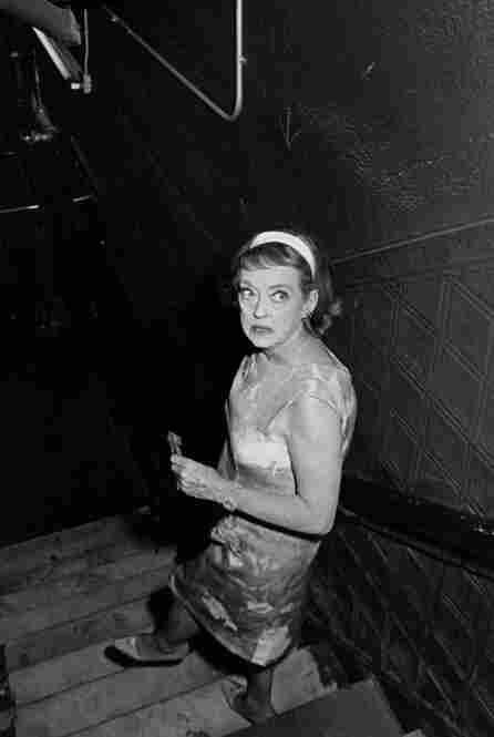 Bette Davis in a stairwell.