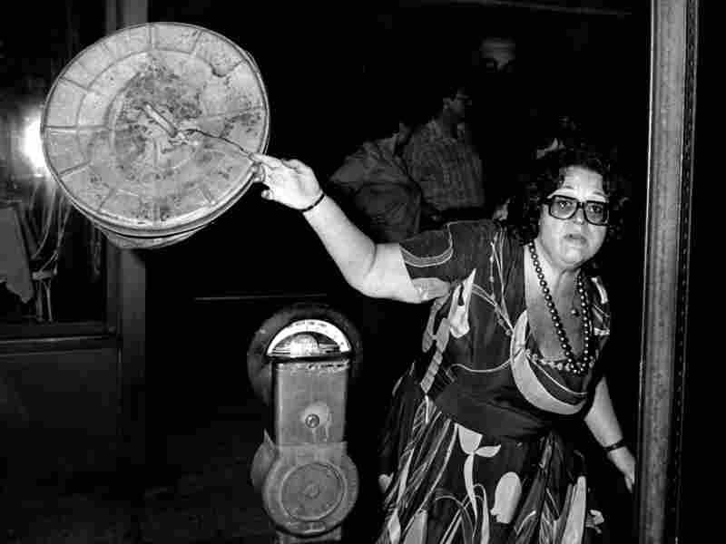 Elaine Kaufman shoos Galella away outside Elaine's Restaurant in New York City.