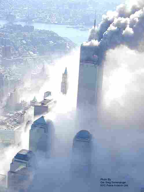 A World Trade Center tower burns after being hit by a passenger jet in New York.