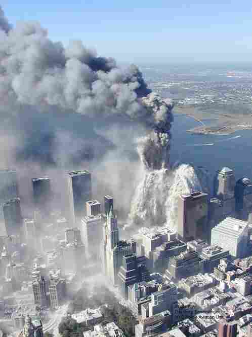 This image and the next show one of the towers of the World Trade Center beginning to crumble.