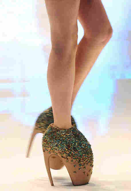 "McQueen's originality was not only limited to his textile creations. A model wears a pair of McQueen's ""armadillo"" shoes at the Paris Womenswear Fashion Week in June 2009."