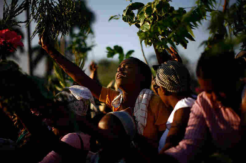 Women participate in a morning prayer service Feb. 14 in the Champ de Mars square. Haiti's three-day Carnival, a national holiday, was called off and replaced with a period of mourning one month after the quake.