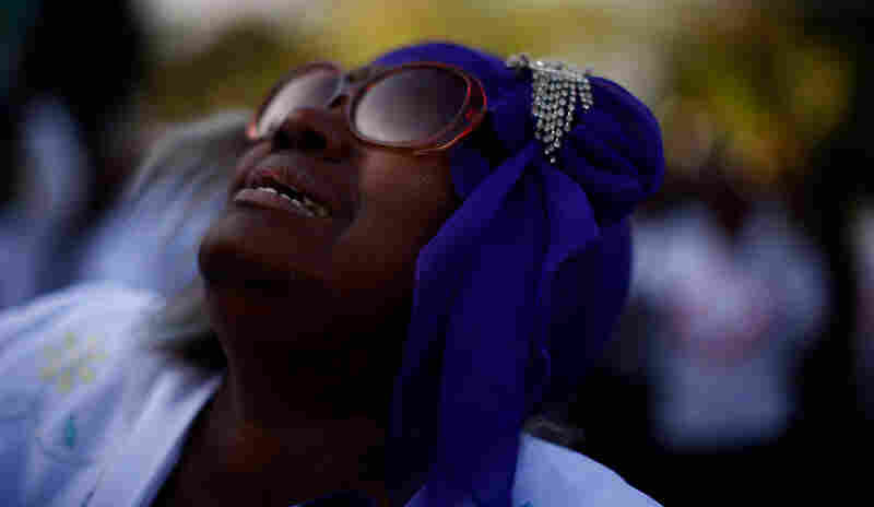 A woman cries during a prayer for the people of Haiti on Feb. 14 in downtown Port-au-Prince.
