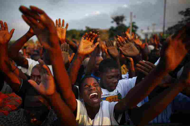 Hundreds of thousands of Haitians gathered around the collapsed  National Palace on Feb. 12, 2010, for a rally of mourning and remembrance one month after the earthquake.
