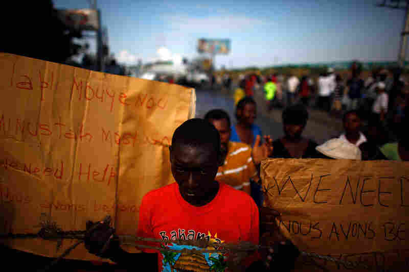 Haitians, now further displaced by floodwaters from the season's first major rain, spontaneously demonstrated on Feb. 11 to demand shelter, water and food.
