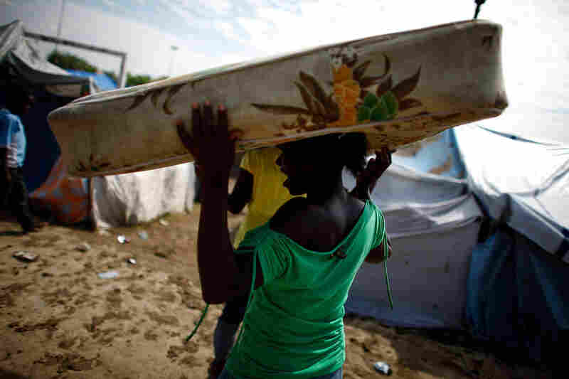 After heavy rains and flooding, Haitians in a displacement camp were forced to move to another area. The rainy season begins in March, which will cause a new set of logistical problems.