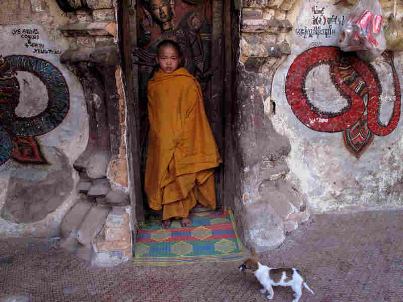 A novice Buddhist monk stands in a doorway at a monastery in eastern Shan state. Nearly everyone in this military-ruled country is Buddhist.