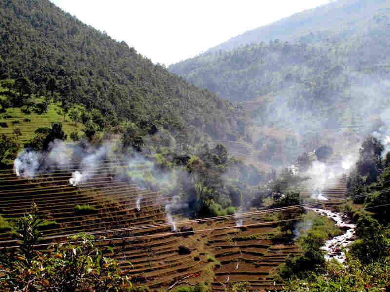 Farmers burn fields along the road to Loi Mwe in eastern Shan state, which is adjacent to China, Laos and Thailand. The Mekong makes its way south along Shan's border with Laos.