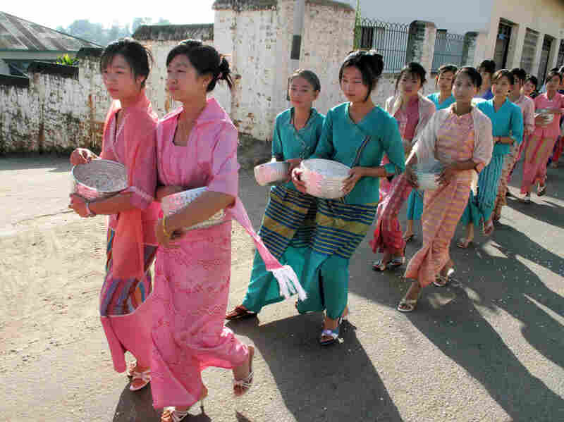 Women in Kengtung participate in a procession to a local monastery.