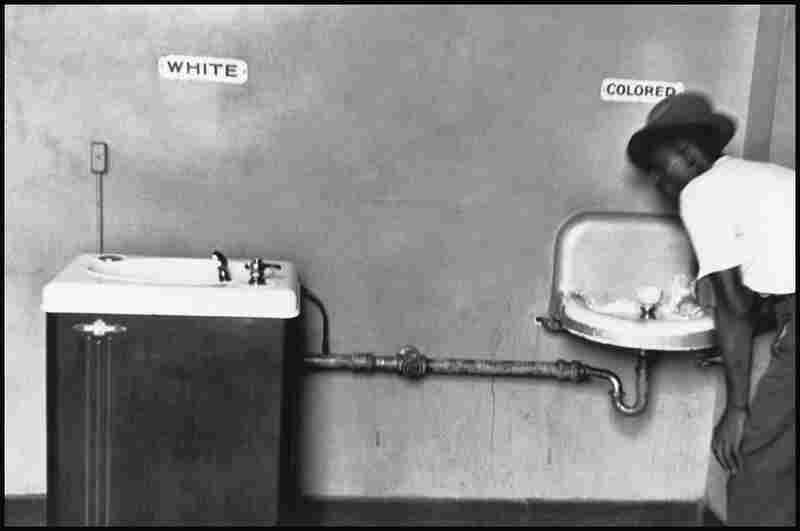 Elliott Erwitt is most well-known for his often witty or satirical images. Other photos by the photographer show the sad scene of segregation. His collection alone, including this photograph from North Carolina in 1950, is also of inestimable value.