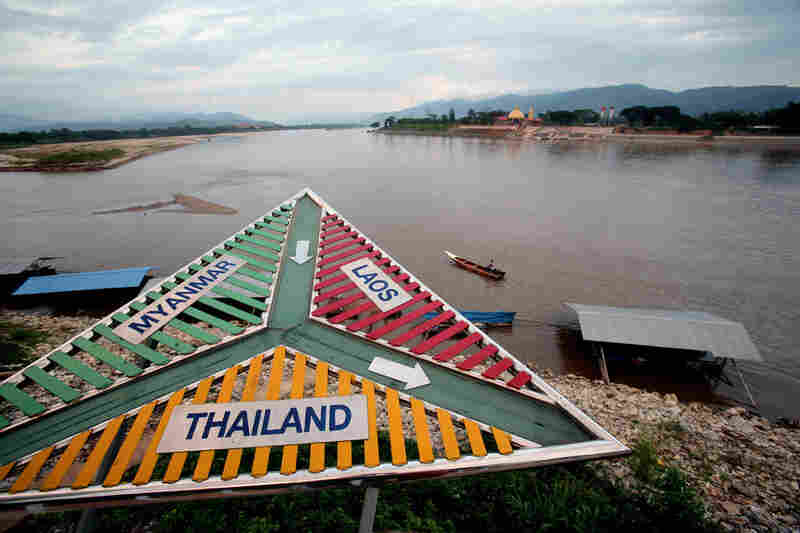 Signs in Sop Ruak, Thailand, point the directions to three of the countries that make up the notorious drug-producing and trafficking area along the Mekong River known as the Golden Triangle.