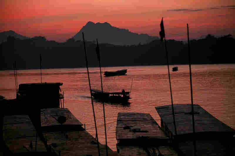 The sun sets over the Mekong in Luang Prabang.